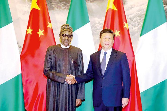 Le président nigérian et son homologue chinois lors de la signature du protocole d'accord. Photo: D. Aliyou.
